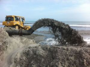 Sediment from the ocean is pumped onto the beach.