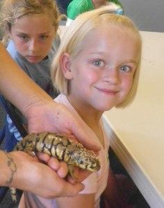 Riley meeting a salamander in camp