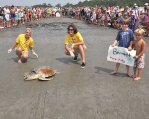 Willow, a sea turtle biologist, is pictured on the left helping with a sea turtle release