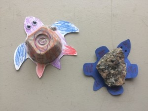 These different crafts used different materials for the turtle shells; the shell on the left is a paper egg carton and the shell on the right is a rock