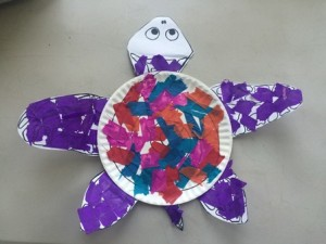 Using tissue paper is a fun way to color your sea turtle
