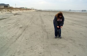Kristin measures the sand compaction on a nourished beach