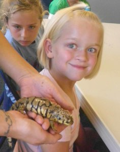 Riley meeting a salamander in camp