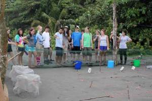 The group looks over the turtle nursery where hatchlings will boil from their nests