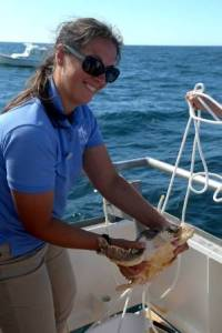 Julie, Aquarium Curator, gets ready to release one of our yearling loggerheads